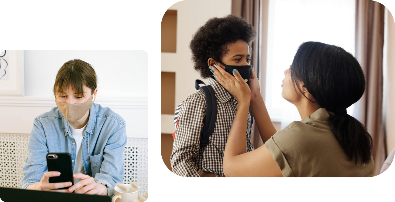 Person wearing a face mask looking at phone and person putting a face mask on a child